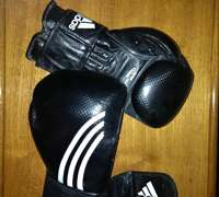 Gloves fit to punch some bags at London's All Star Boxing Gym