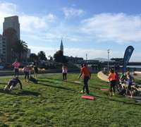 A Fitmob class overtakes a SF green space